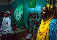 Sufi people go into a trance during a ceremony, Harari region, Harar, Ethiopia (Eric Lafforgue) Tags: world africa travel people color green horizontal night religious outdoors togetherness dance clothing worship veiled singing dancing african flag muslim islam religion praying group performance performing ceremony dancer unescoworldheritagesite celebration indoors event spirituality ethiopia sufi sufism adultsonly trance hornofafrica chanting eastafrica harar 3people abyssinia threepeople harari harariregion ethio163031