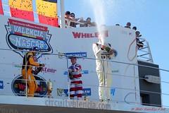 champan en el podio