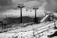 Ski Lift (jasonmgabriel) Tags: bw white mountain snow black ski monochrome clouds fence scotland chair lift post highland nevis