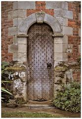 Charlecote Hall (Octagonal Turret Entrance). (tetleyboy) Tags: door wood brick history grass stone arch path shrub elizabethan nationaltrust stud facebook 16thcentury historicalbuilding listedbuilding