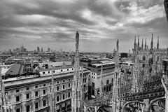 Guardians of Milan (Funkraft) Tags: blackandwhite cathedral dom duomo milan milano mailand towers panorama town clouds architecture architektur