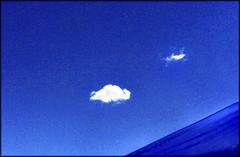 Picnic table umbrella (Bob R.L. Evans) Tags: blue sky clouds space negative minimalism simple