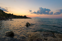 Sunset on Wild Bay (krugli) Tags: travel sunset summer nature water landscape island evening bay coast rocks surf view angle outdoor stones tide wide scenic greece coastline seashore seaview zakynthos d600 sescape