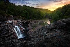 Yngeredsforsen (Arvid Bjrkqvist) Tags: trees light sunset sky sun water colors clouds forest flow evening waterfall rocks stream sweden ullared yngeredsforsen