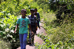 Children of the Yangon water pipe 48 (I.M.W.) Tags: boys water smile canon 50mm rust iron walk steel yangon burma pipe myanmar dslr pipeline waterpipe watermain rangoon thanaka waterpipeline canonef50mm114 canon550d