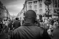 crowds (streetphotographylondon) Tags: street city portrait people urban white black london 35mm candid streetphotography photojournalism fujifilm streetphoto oxfordstreet oxfordcircus streetfashion fujifilmx100