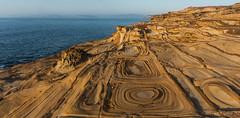 Sandstone patterns (NettyA) Tags: morning water rock sunrise rocks patterns australia pacificocean coastal nsw newsouthwales geology centralcoast puttybeach 2014 bouddinationalpark sonynex6 spanreunion