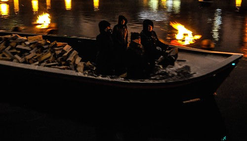 WaterFire Volunteer Crew works hard to keep the fires lit and keep themselves warm! Photo by Luis Andrade.