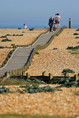 Dugeness Headland (beach walkway) - Dungeness, Kent - UK (Andrew_Simpson) Tags: uk greatbritain sea england sky people woman man english beach public person kent seaside boards dof unitedkingdom path depthoffield walkway gb boardwalk dungeness decking channel pathway englishchannel eng thechannel dungenessbeach dungenessheadland
