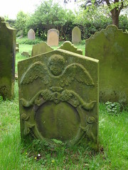 Angel round (Nekoglyph) Tags: trees green graveyard stone angel circle carved wings yorkshire feathers historic round cherub gravestone oldchurch holycross whorlton