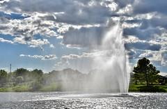 Wind across the pond (stevelamb007) Tags: sun lake nature fountain weather clouds pond nikon wind chicagobotanicgarden nikkor18200mm stevelamb flickriver d7200