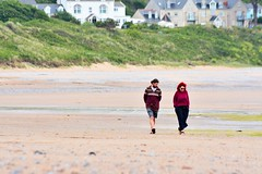in sync (doods-on-and-off) Tags: sea house green beach grass coast sand couple sunny