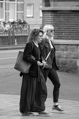 Glasses vs Sunglasses (Dutch_Chewbacca) Tags: life street camera city girls portrait people urban bw woman netherlands girl monochrome beauty canon photography eos women outdoor candid nederland strangers sigma streetlife human denbosch brabant stad shertogenbosch noordbrabant behaviour nocolor straatfotografie 550d
