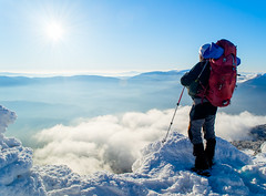 Man above the clouds (oleksandr.mazur) Tags: activity adventure afternoon alone alpine backpack blue clear cloud day extreme fog freedom glow highland hiking hill landscape light looks man mist mountain mountaineering nature object one outdoor peak people rays scenic season sky skyline snow snowy sports stand summit sun sunny sunshine top tourism tourist travel trekking vacation view white winter