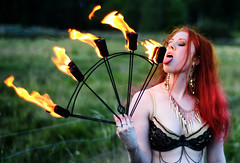 Licking the Flames (henriksundholm.com) Tags: portrait people woman hot sexy girl face tongue lady mouth fire person necklace chains model closed pretty erotic hand sweden stockholm bokeh smoke teeth flames bra bellydancer lick lips sensual redhead burning rings burn oral heat ear sverige veins earrings sexual eyesclosed licking varga jrvafltet firefans tensta
