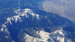 Somewhere over the Rockies (BarryFackler) Tags: trip mountain snow mountains window airplane landscape rockies flying scenery outdoor aircraft aviation flight jet scene aerial vista vehicle rockymountains americanairlines windowseat 2016 boeing757 barryfackler barronfackler