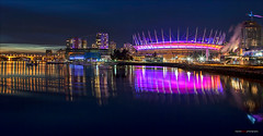 New Year Skyline (Clayton Perry Photoworks) Tags: winter panorama canada skyline night vancouver buildings reflections lights bc falsecreek newyearsday bcplace explorebc explorecanada