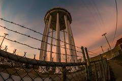 Below Freezing/Water Tower (severalsnakes) Tags: sunset fence pentax watertower fisheye chainlink powerlines missouri barbedwire sedalia k30 rokinon835