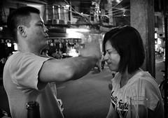 massage or assault? (gunzzel) Tags: street bw woman hot sexy girl beauty blackwhite vietnamese pentax streetphotography babe vietnam saigon hochiminhcity buivienstreet vietnamesewoman pentaxlimitedlenses pentaxsmcda21mmf32allimited pentaxk3