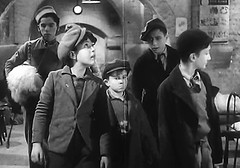 Almost ready (theirhistory) Tags: uk london film boys hat kids children war wwii kinderen tie crime jacket cap gb ww2 jumper 1942 adults cellar villians bfilm johntacchi
