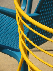 Colours of summer (Claire Wroe) Tags: blue sun yellow manchester concrete outside restaurant cafe chair seat line plastic canteen coop curve seating cooperative