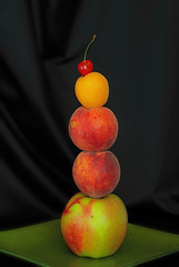 fruit acrobatics :) (rgbshot72) Tags: red summer food orange black color apple nature fruits yellow fruit cherry photo healthy nikon background great peach indoor delicious apricot vitamins d800e