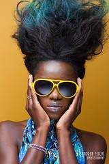 AmieC-02 (Feicht Photography) Tags: beauty sunglasses fashion yellow gelb brille beautyshot schmuck bunt sonnenbrille beautyful haare silber blackwoman highfashion bluedress africanwoman highhair blaueskleid studioaufnahme onelightsetup buntehaare feichtphotography