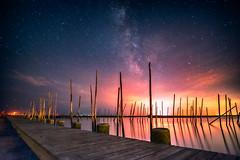 Milky Way vs Light Pollution II (DJawZ) Tags: ocean city sunset sky water skyline night clouds dark skyscape stars landscape bay pier dock long exposure nightscape outdoor astro atlantic astrophotography serene hdr milkyway