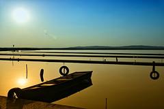 Lost harbor (Amos's photos) Tags: hoya filter 1000 golden hours long exposure reflection harbor water sky sun clouds stick wheel boat circular polarizer