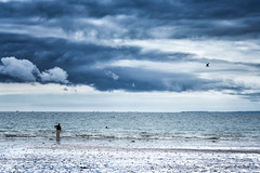 Learning to surf (Hugh Rawson) Tags: france sky stgermainsuray normandy beach clouds cloud