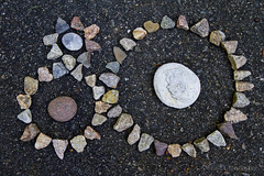Stone Ground (brucetopher) Tags: flickrfriday gear gears stone pebble sculpture earth ground rocks rock triangles
