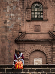 Andean woman working with the spinning wheel - Cusco Cathedral- Peru (kañometa) Tags: peru cuzco cusco plaza mayor square cathedral catedral inca inka empire imperio andes