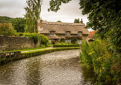Quintessential England. (ian.emerson36) Tags: thorntonledale yorkshire northyorkshire england summer colourful thatched cottages river stream picturesque flowers beauty stone photographic postcard canon