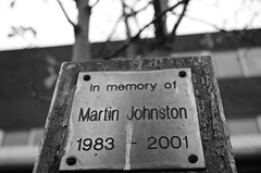 In Memory Of... (Blake Murray - Photography) Tags: people blackandwhite bw music white black building college monochrome plaque photography photo nikon photos bass buried room rip screen safety depression bolt strap violence and bolts rest safe piece dearest lcdscreen liking bolted in restinpiece martinjohnston nikond5100 madeformusic