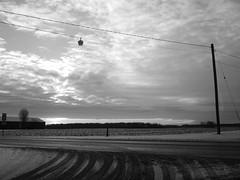Clouds (joeldinda) Tags: winter sky blackandwhite bw cloud snow weather fuji seasons michigan powerlines fields mulliken 2012 farmyard fujifilmf10