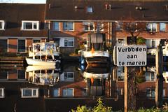 Forbidden to dock... (lienete) Tags: street city houses holland reflection water docks boats canals leidschendamvoorburg