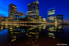 London Docklands (adrianchandler.com) Tags: longexposure blue england sky urban reflection london bulb night canon buildings corporate evening cityscape skyscrapers unitedkingdom outdoor centre wideangle center business mirrored docklands bluehour canarywharf financial 6d starlight 14mm flickrtravelaward