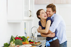 Young couple in their kitchen (kieranlimbo) Tags: people woman house man cute male love home boyfriend kitchen beautiful smile smiling female breakfast dinner laughing fun happy person hugging hug girlfriend couple sweet weekend interior young relaxing adorable lifestyle happiness romance fresh sensual relationship attractive romantic environment laughter casual emotional cheerful playful carefree bonding preparing passionate embracing interacting