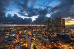 Stormy Skies over Downtown L.A. (Michael Bandy) Tags: california roof sunset sky storm rooftop skyline architecture clouds buildings landscape la losangeles cityscape skyscrapers cityhall southerncalifornia clioudy
