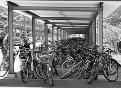 Interlaken bike park 121 (saxonfenken) Tags: 6914trans 6914 bicycle blackandwhite interlaken switzerland transpor parking bikeracks urban framed pregamewinner herowinner challengeyouwinner challengeyou perpetual gamesweep