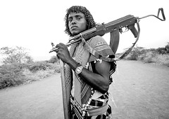 Afar Tribe Warrior, Afambo, Afar Regional State, Ethiopia (Eric Lafforgue) Tags: africa portrait people blackandwhite haircut men horizontal hair outdoors photography gun day adult african culture tribal weapon warrior tradition ethiopia tribe ethnic hairstyle curlyhair cultures anthropology oneperson hornofafrica ethnology ethiopian afar eastafrica humanhair kalashnikov realpeople 2025years humanface colorimage onlymen onemanonly onematuremanonly danakil africanethnicity pastoralists 1people indigenousculture africanculture nomadicpeople afambo assaita asaita assayta ethio1410695