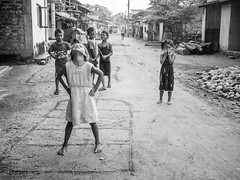 (milan syangbo) Tags: street nepal playing game monochrome childhood kids fun blackwhite candid streetphotography streetlife nepalese blackdiamond candidshot olympusomdem10