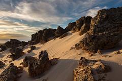Tracks on Sand through Rocks (--Welby--) Tags: ocean road sunset sea beach water rock stone clouds coast sand rocks path dunes dune tracks peaceful crab australia cable western wa kimberly hermit broome