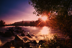 Last sun rays (dannicamra) Tags: autumn sunset sun tree nature water stone river germany landscape bayern bavaria nikon wasser sonnenuntergang herbst natur rays fluss landschaft sonne stein langzeitbelichtung d5100