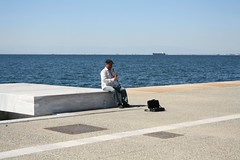 ...and he was playing jazz~ (Teteel) Tags: sea people musicians pier ship greece thessaloniki  acedonia
