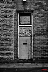 The print shop (CJS*64) Tags: door bw building shop wall blackwhite nikon bolton frontdoor brickwork printers cjs nikkorlens hardmans theprintshop 18mm105mmlens nikond3100 craigsunter cjs64