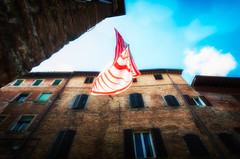 spirits are flying (Eddy Alvarez) Tags: blue sky italy art architecture clouds flying symbol wind outdoor spirit flag sienna