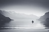 Walking on the Lake (Maximecreative) Tags: blackandwhite mist lake mountains water silhouette clouds canon switzerland daylight boat spring fisherman brienzersee balance f4 interlaken calmness 24105mm