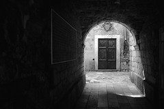 di profilo (francesco melchionda) Tags: street light blackwhite doors opposite profile kotor obscurity