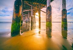 Under the pier (meeyak) Tags: california longexposure travel sunset vacation art texture beach nature water architecture clouds outdoors sand nikon cloudy details newportbeach newport slowshutter orangecounty oc westcoast d800 underthepier meeyak